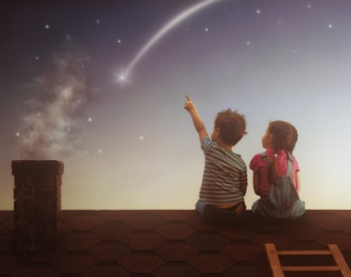 Boy and girl make a wish